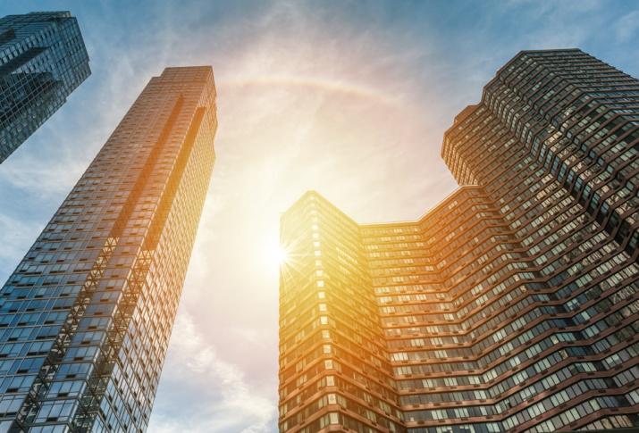 YSG Solar, Sun shining through high rises in New York City, NY